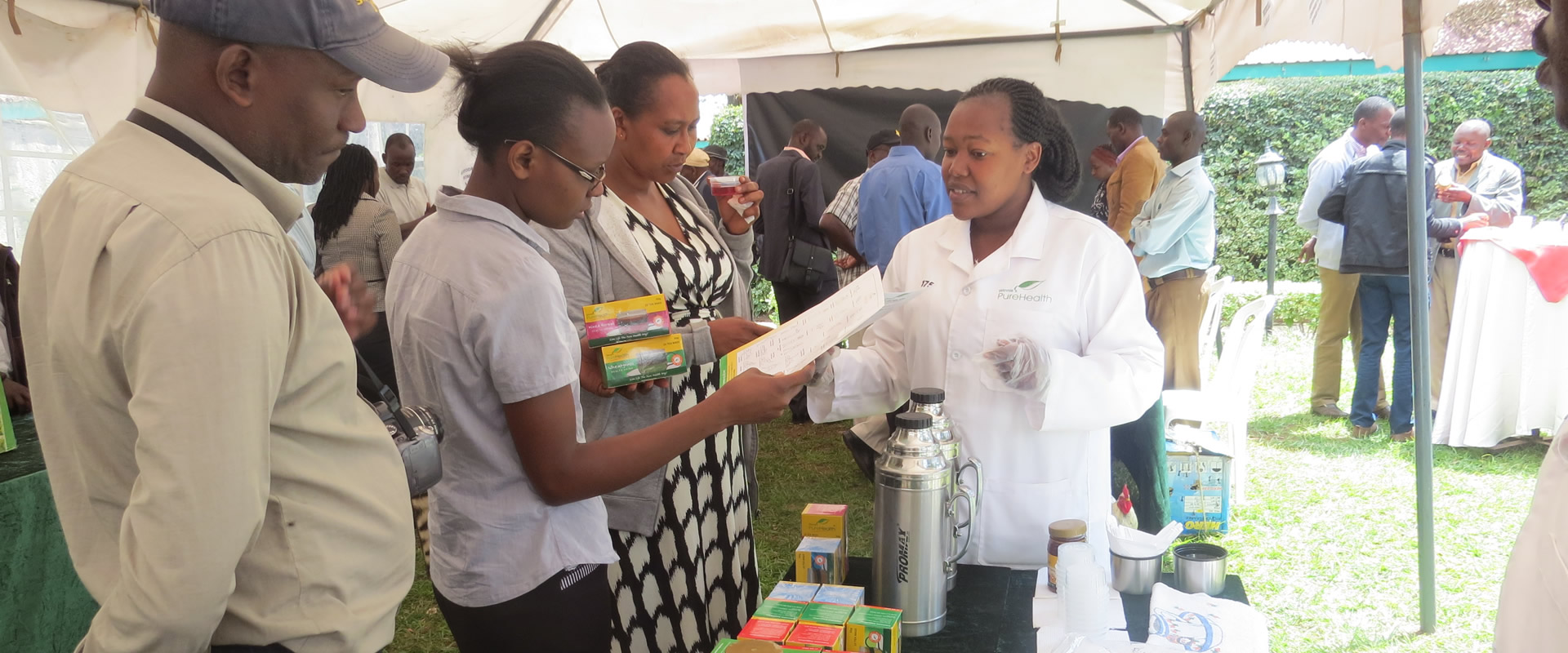 Participants engaging with Winnie's Pure Health exhibitors during organic market forum