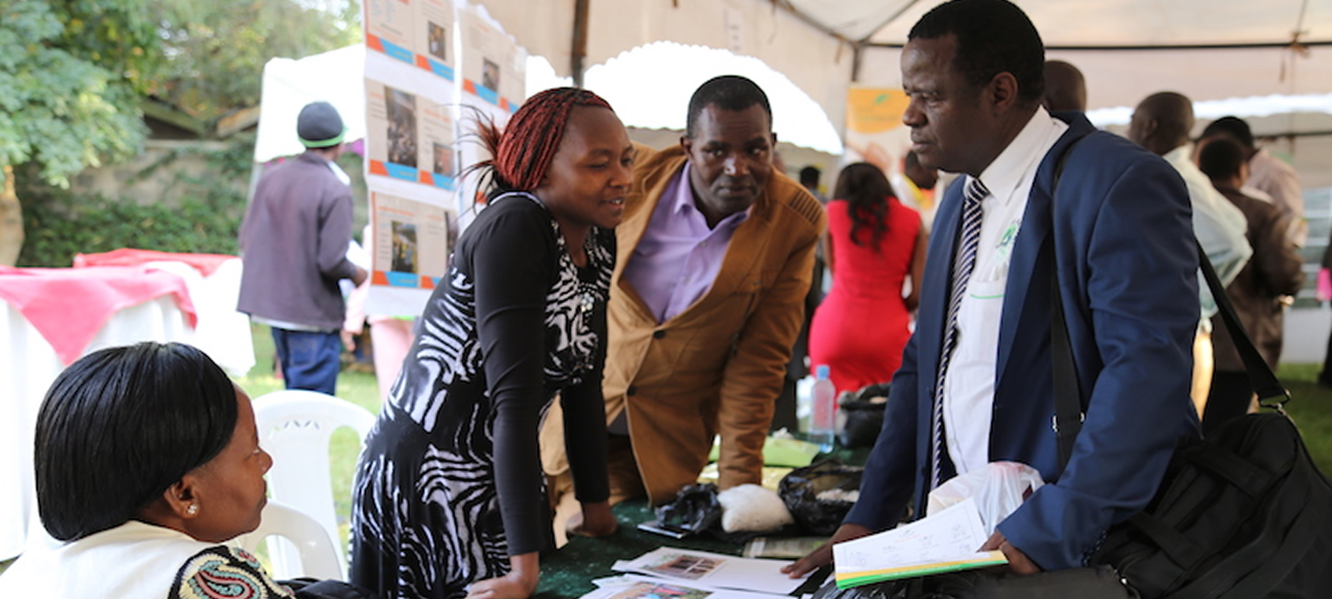 Mr. Zachary Makanya, Country Coordinator- PELUM Kenya engaging with Mukika SHG exhibitors
