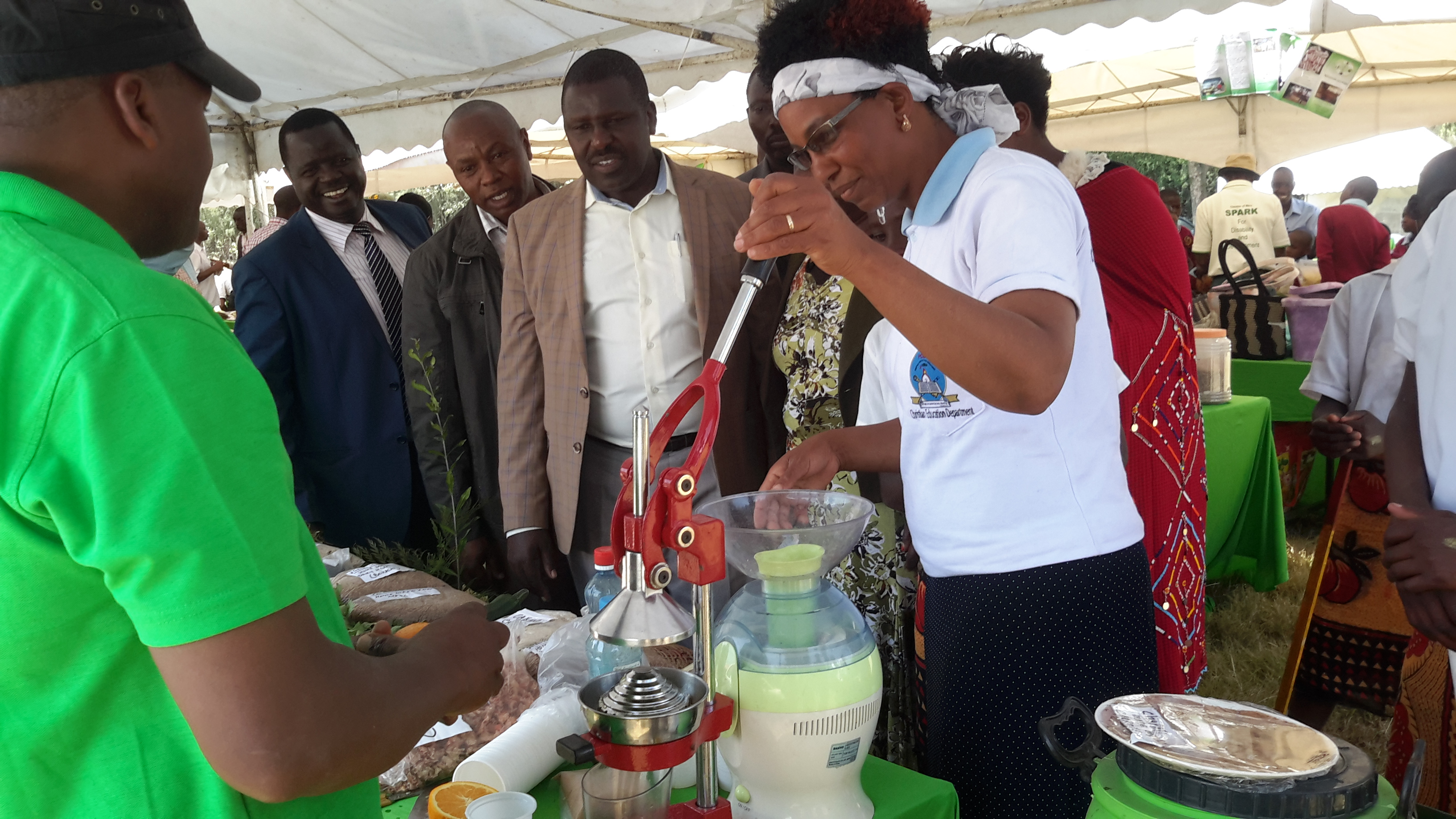 The Country Coordinator, Mr. Zachary Makanya accompanied by the County Environment Commissioner, Nakuru during Farmer's Agro-ecology Forumduring an exhibition